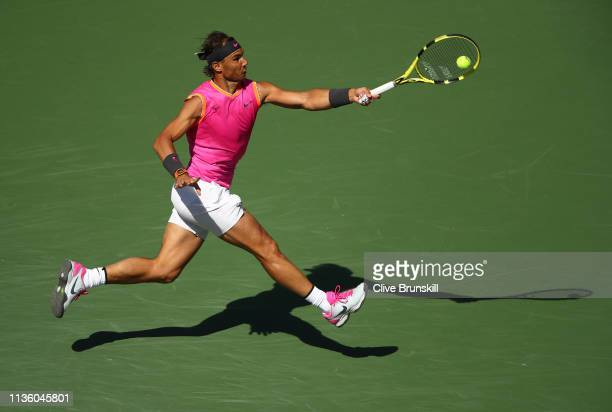 Rafael Nadal of Spain jumps into the air to play a forehand against Karen Khachanov of Russia during their men's singles quarter final match on day...