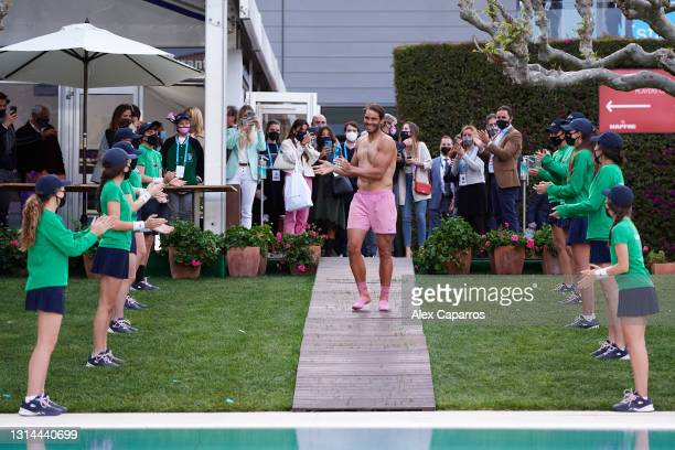 Rafael Nadal of Spain jumps into the pool after his victory against Stefanos Tsitsipas of Greece in their final match during day seven of the...