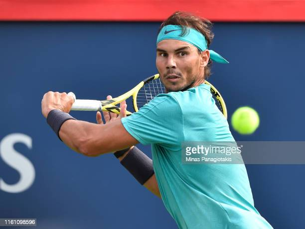 Rafael Nadal of Spain keeps his focus on the ball against Daniil Medvedev of Russia during the mens singles final on day 10 of the Rogers Cup at IGA...