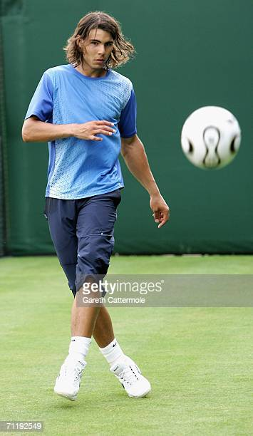 Rafael Nadal of Spain kicks a football during the Stella Artois Championships at Queen's Club on June 13, 2006 in London, Engand.