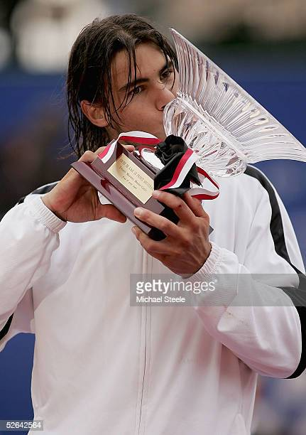 Rafael Nadal of Spain kisses the trophy after his victory in the final against Guillermo Coria of Argentina at the ATP Master Series at the Monte...