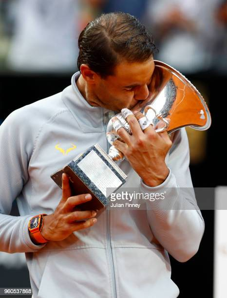 Rafael Nadal of Spain kisses the trophy in celebration after the Mens Singles final match between Rafael Nadal and Alexander Zverev on Day Eight of...