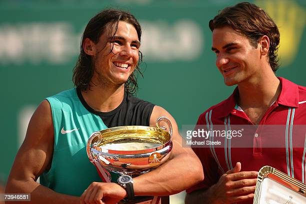 Rafael Nadal of Spain laughs with Roger Federer of Switzerland on the podium after Nadal's victory by 6464 during the Final on Day Six of the Masters...