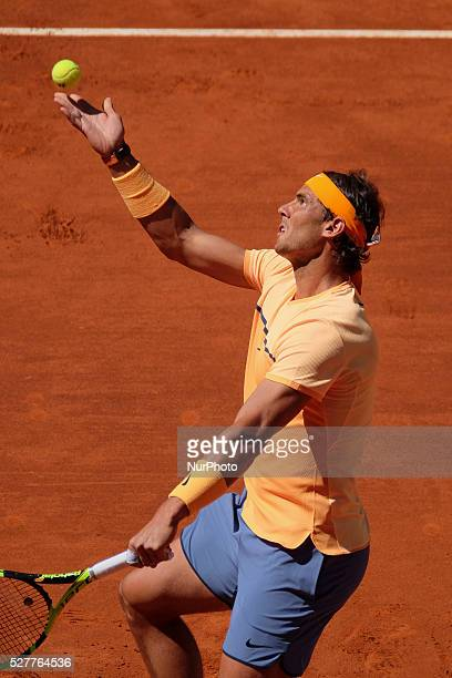 Rafael Nadal of Spain leaps into the air to play a forehand against Andrey Kuznetsov of Russia in their second round match during day four of the...