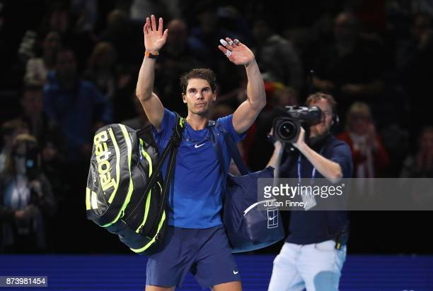 Rafael Nadal of Spain leaves the court after defeat in his Singles match against David Goffin of Belgium during day two of the Nitto ATP World Tour...