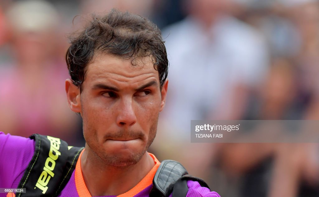 Rafael Nadal of Spain leaves the court after he lost his quarter-final against Dominic Thiem of Austria during the ATP Tennis Open tournament on May 19, 2017 at the Foro Italico in Rome. Austria's Dominic Thiem sent Rafael Nadal crashing out of the Rome Masters with a 6-4, 6-3 quarter-final victory, ending the Spaniard's 17-match winning run. /
