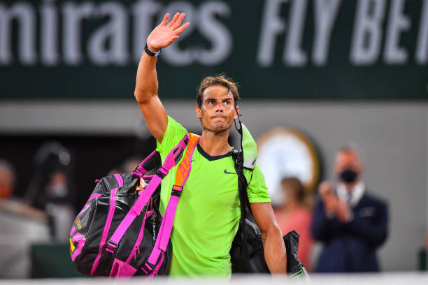 Rafael NADAL of Spain leaves the court dejected during the ninth round of Roland Garros at Roland Garros on June 11, 2021 in Paris, France.