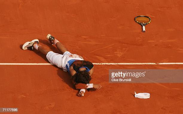 Rafael Nadal of Spain lies on the clay after defeating Roger Federer of Switzerland during the Men's Singles Final on day fifteen of the French Open...