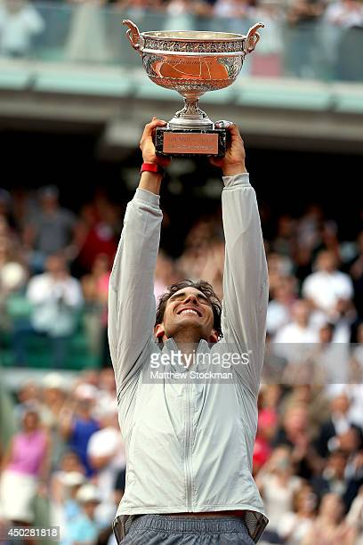 Rafael Nadal of Spain lifts the Coupe de Mousquetaires after victory in his men's singles final match against Novak Djokovic of Serbia on day fifteen...