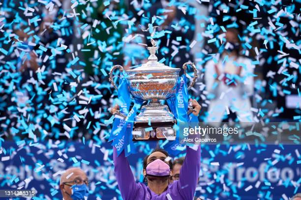 Rafael Nadal of Spain lifts the trophy after his victory against Stefanos Tsitsipas of Greece in their final match during day seven of the Barcelona...