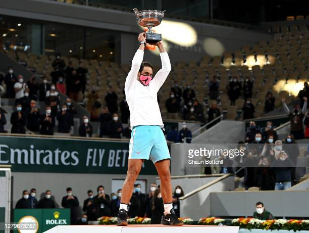 Rafael Nadal of Spain lifts the winners trophy following victory in his Men's Singles Final against Novak Djokovic of Serbia on day fifteen of the...