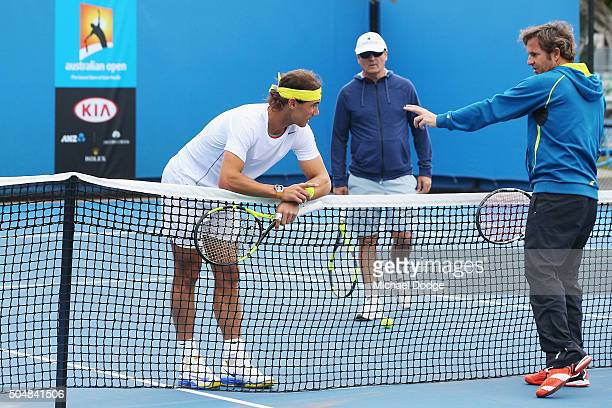 Rafael Nadal of Spain listens to an assistant next to head coach Toni Nadal during a practice session ahead of the 2016 Australian Open at Melbourne...