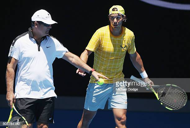 Rafael Nadal of Spain listes to coach Toni Nadal during a practice session ahead of the 2016 Australian Open at Melbourne Park on January 16 2016 in...
