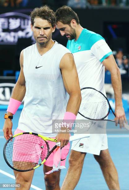 Rafael Nadal of Spain looks dejected after he pulled out in the fifth set due to an injury in his quarterfinal match against Marin Cilic of Croatia...