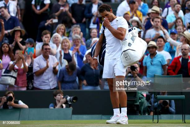 Rafael Nadal of Spain looks dejected in defeat after the Gentlemen's Singles fourth round match against Gilles Muller of Luxembourg on day seven of...