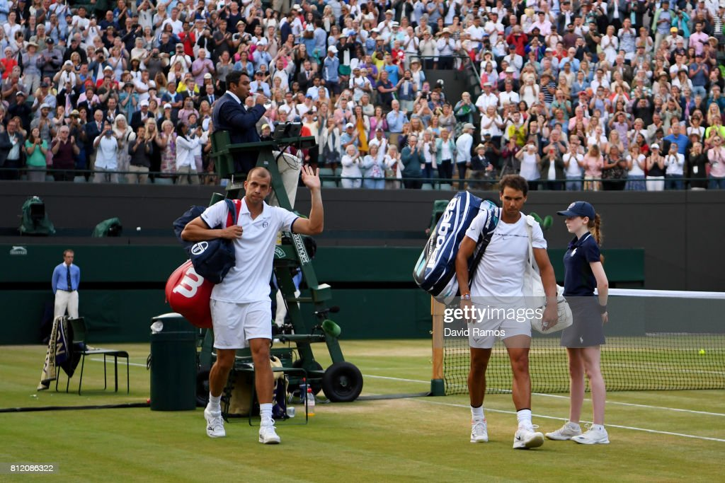 Rafael Nadal of Spain looks dejected in defeat as Gilles Muller of Luxembourg acknowledges the crowd after the Gentlemen's Singles fourth round match against on day seven of the Wimbledon Lawn Tennis Championships at the All England Lawn Tennis and Croquet Club on July 10, 2017 in London, England.