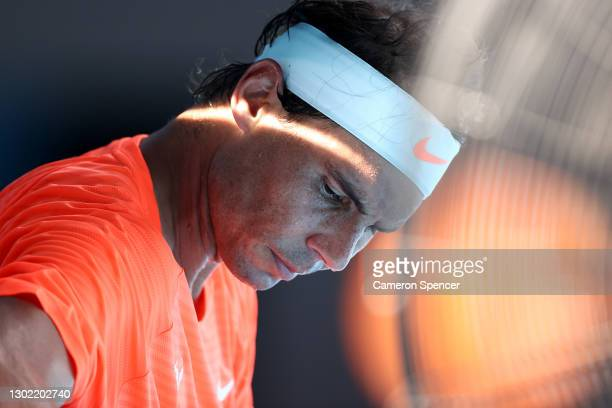Rafael Nadal of Spain looks on between games in his Men's Singles fourth round match against Fabio Fognini of Italy during day eight of the 2021...