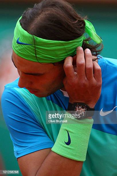 Rafael Nadal of Spain looks on during the men's singles third round match between Rafael Nadal of Spain and Lleyton Hewitt of Australia at the French...