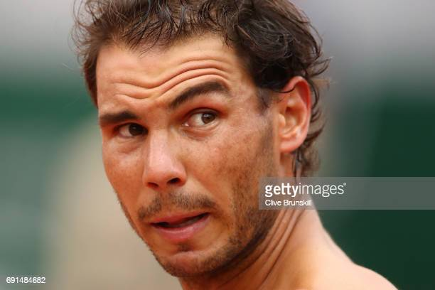 Rafael Nadal of Spain looks on during the men's singles third round match against Nikoloz Basilashvili of Georgia on day six of the 2017 French Open...