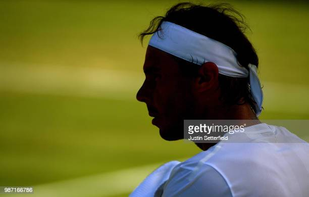 Rafael Nadal of Spain looks on from his seat as he plays against Lucas Pouille of France during the Aspall Tennis Classic at Hurlingham on June 29...