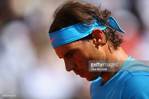 Rafael Nadal of Spain looks on in his Men's quarter final match against Novak Djokovic of Serbia on day eleven of the 2015 French Open at Roland...