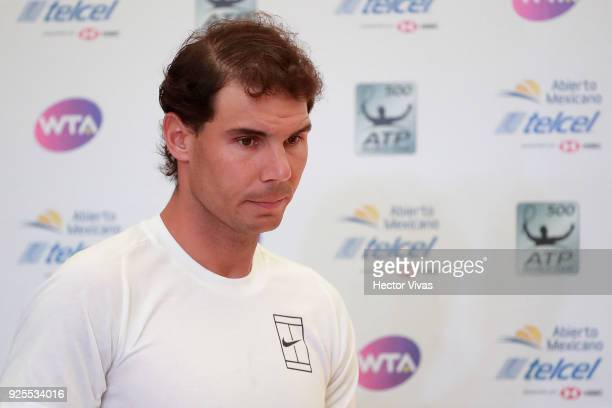 Rafael Nadal of Spain looks on prior a press conference to announce his retirement from the the Telcel Mexican Open 2018 at Mextenis Stadium on...