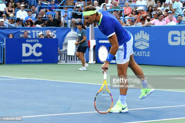 Rafael Nadal of Spain looks to ee where the ball hit the line during a match against Lloyd Harris of South Africa on Day 6 during the Citi Open at...