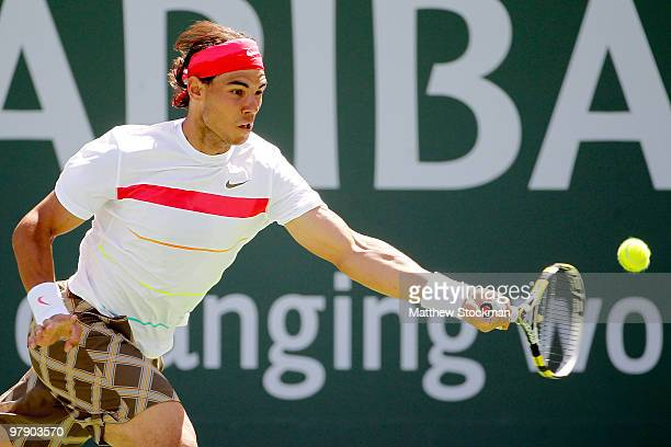 Rafael Nadal of Spain lunges for a shot against Ivan Ljubicic of Croatia during the semifinals of the BNP Paribas Open on March 20 2010 at the Indian...