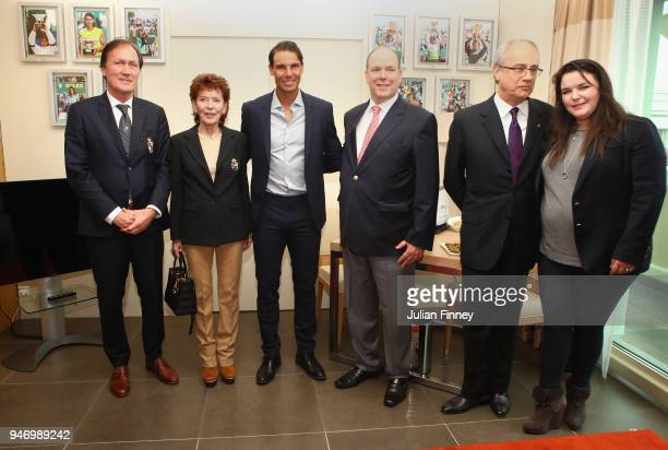 Rafael Nadal of Spain meets with Albert II Prince of Monaco ElysabethAnne de Massy and Melanie de Massy in Nadal's lucky hotel suite during Day Two...