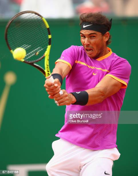 Rafael Nadal of Spain plays a backhand against Albert RamosVinolas of Spain in the final on day eight of the Monte Carlo Rolex Masters at MonteCarlo...