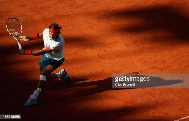 Rafael Nadal of Spain plays a backhand against David Ferrer of Spain in their quarter final round match during day six of the Internazionali BNL...