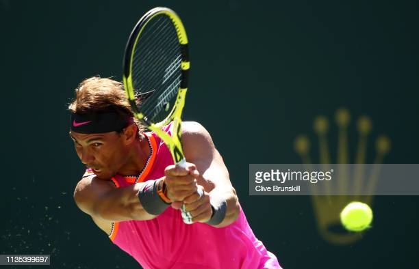 Rafael Nadal of Spain plays a backhand against Diego Schwartzman of Argentina during their men's singles third round match on day nine of the BNP...