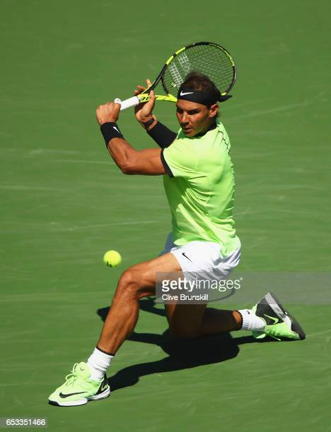 Rafael Nadal of Spain plays a backhand against Fernando Verdasco of Spain in their third round match during day nine of the BNP Paribas Open at...
