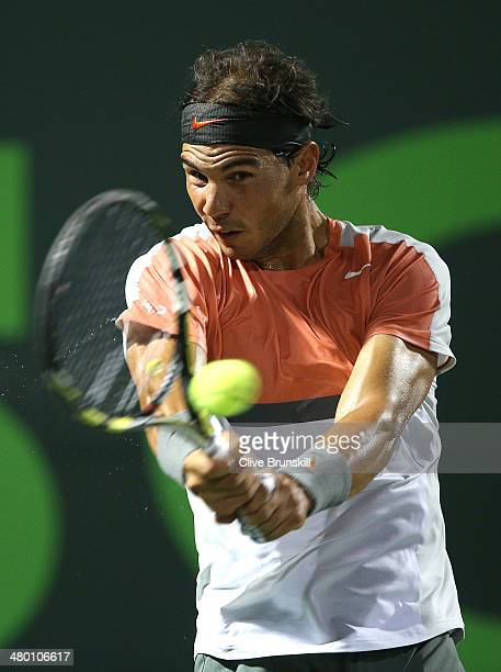 Rafael Nadal of Spain plays a backhand against Lleyton Hewitt of Australia during their second round match during day 6 at the Sony Open at Crandon...