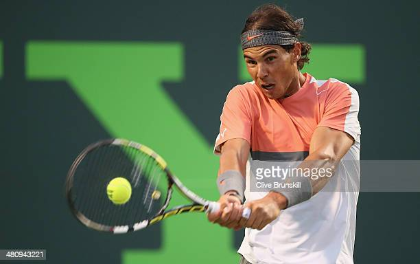 Rafael Nadal of Spain plays a backhand against Milos Raonic of Canada during their quarter final round match during day 11 at the Sony Open at...