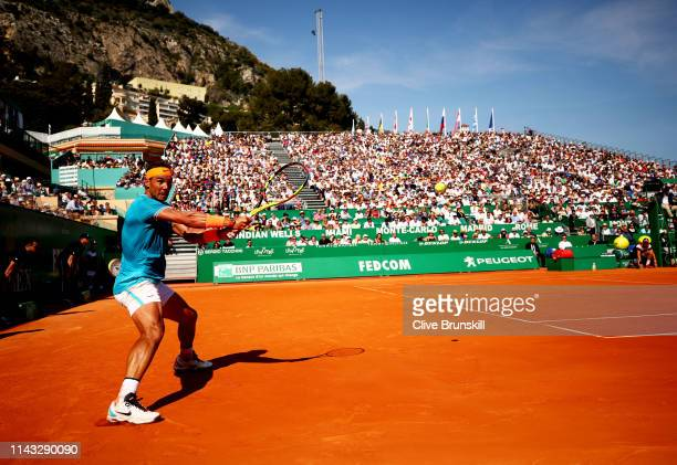Rafael Nadal of Spain plays a backhand against Roberto Bautista Agut of Spain in their second round match during day four of the Rolex Monte-Carlo...