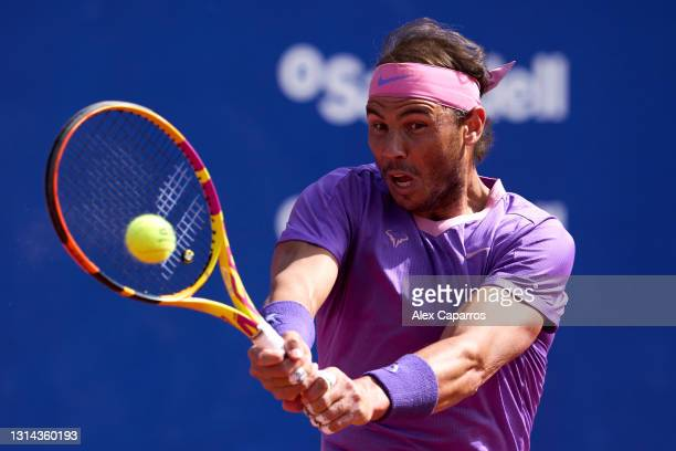 Rafael Nadal of Spain plays a backhand against Stefanos Tsitsipas of Greece in their final match during day seven of the Barcelona Open Banc Sabadell...