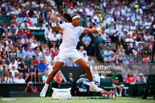 Rafael Nadal of Spain plays a backhand during his Gentlemen's Singles second round match against Donald Young of The United States on day three of...