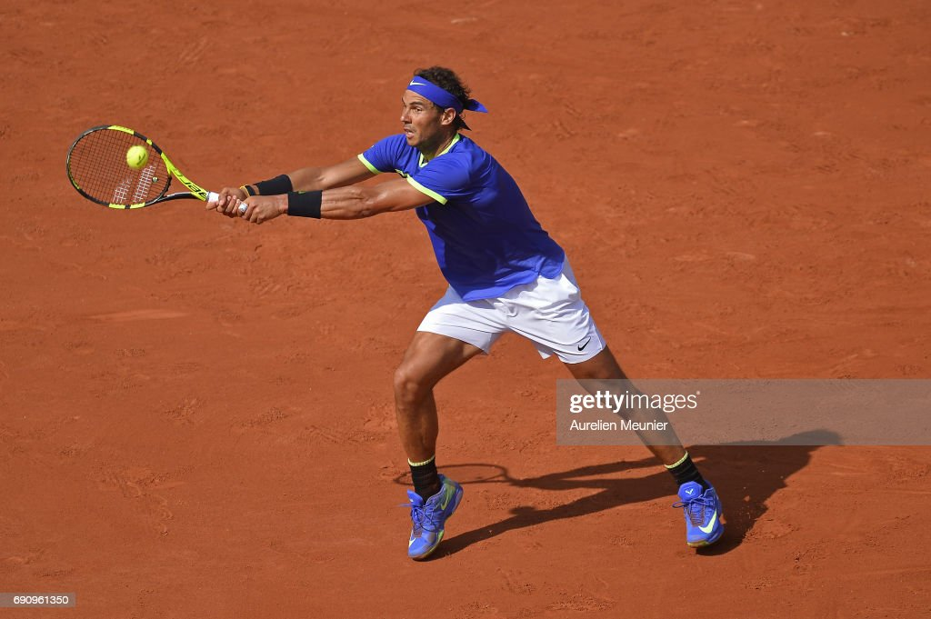 Rafael Nadal of Spain plays a backhand during his men's single match against Robin Hasse of the Netherlands on day four of the 2017 French Open at Roland Garros on May 31, 2017 in Paris, France.