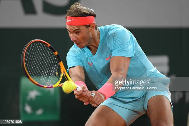 Rafael Nadal of Spain plays a backhand during his Men's Singles Final against Novak Djokovic of Serbia on day fifteen of the 2020 French Open at...