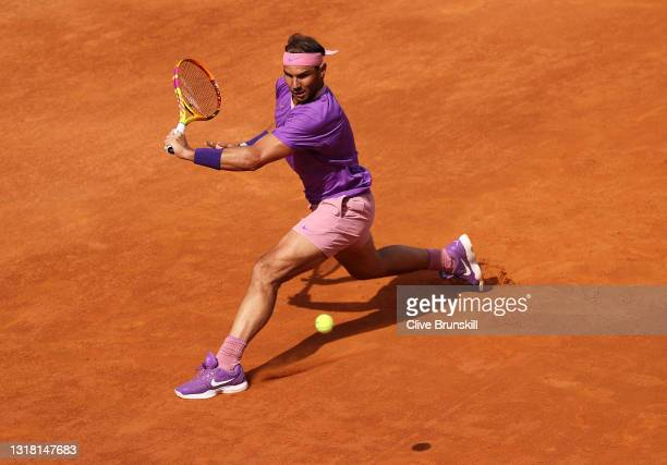 Rafael Nadal of Spain plays a backhand during his semi-final match with Reilly Opelka of USA on Day Eight of the Internazionali BNL D'Italia 2021 at...
