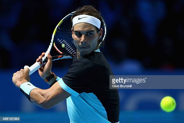 Rafael Nadal of Spain plays a backhand during his straight sets defeat by Novak Djokovic of Serbia during the men's singles semi final match on day...