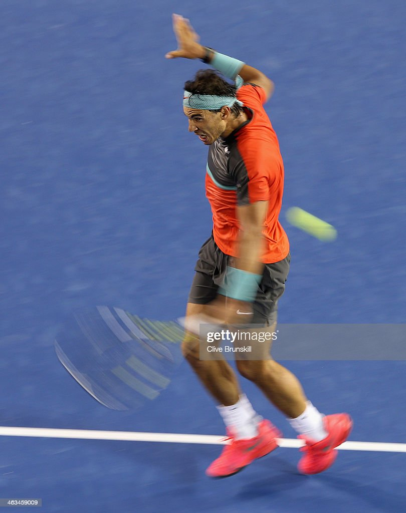 Rafael Nadal of Spain plays a backhand during his straight sets victory in his third round match against Gael Monfils of France during day six of the 2014 Australian Open at Melbourne Park on January 18, 2014 in Melbourne, Australia.