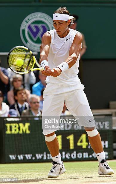 Rafael Nadal of Spain plays a backhand during the men's singles Final match against Roger Federer of Switzerland on day thirteen of the Wimbledon...