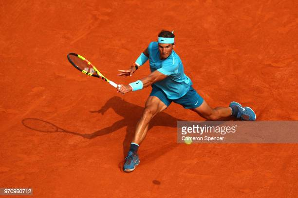 Rafael Nadal of Spain plays a backhand during the mens singles final against Dominic Thiem of Austria during day fifteen of the 2018 French Open at...