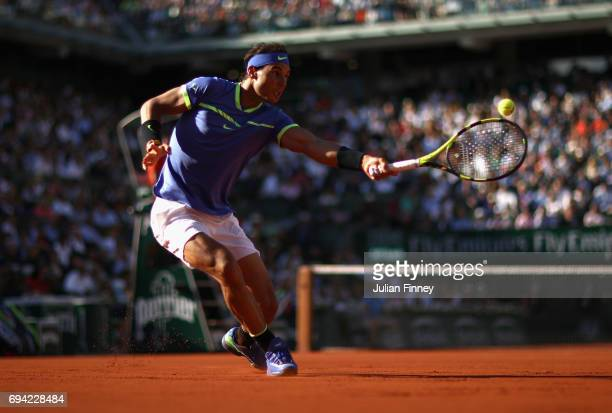 Rafael Nadal of Spain plays a backhand during the mens singles semifinal match against Dominic Thiem of Austria on day thirteen of the 2017 French...