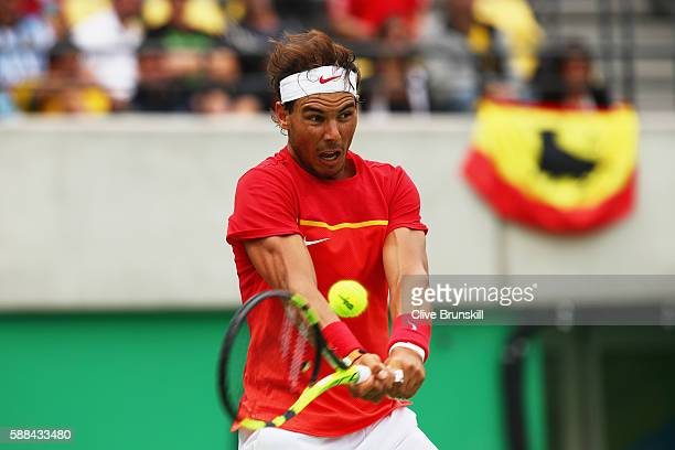 Rafael Nadal of Spain plays a backhand during the men's singles third round match against Gilles Simon of France on Day 6 of the 2016 Rio Olympics at...