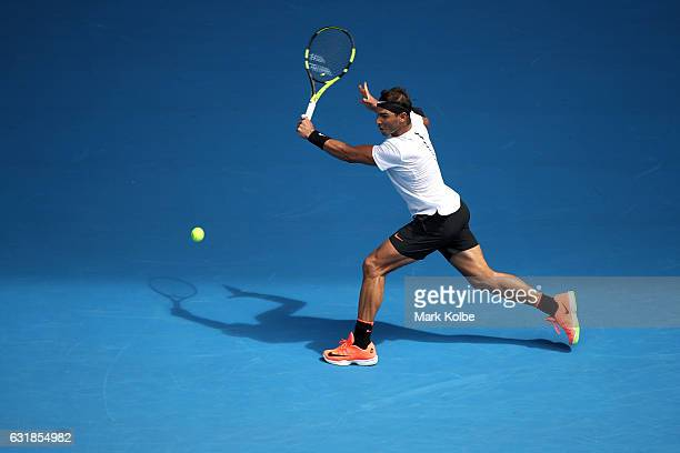 Rafael Nadal of Spain plays a backhand in his first round match against Florian Mayer of Germany on day two of the 2017 Australian Open at Melbourne...