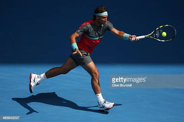 Rafael Nadal of Spain plays a backhand in his fourth round match against Kei Nishikori of Japan during day eight of the 2014 Australian Open at...