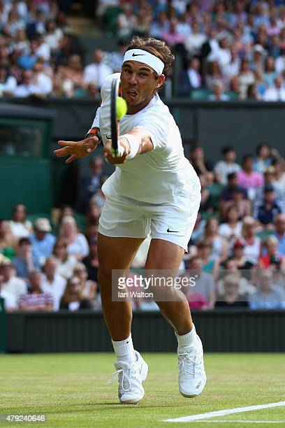 Rafael Nadal of Spain plays a backhand in his Gentlemens Singles Second Round match against Dustin Brown of Germany during day four of the Wimbledon...